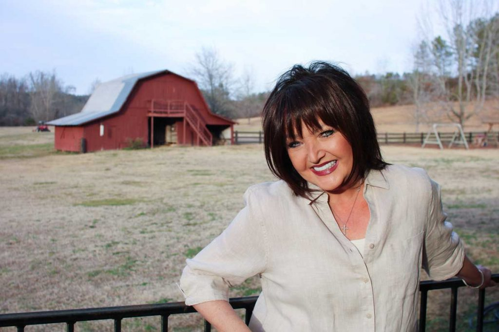 Karen Wheaton Ministries in front of her barn