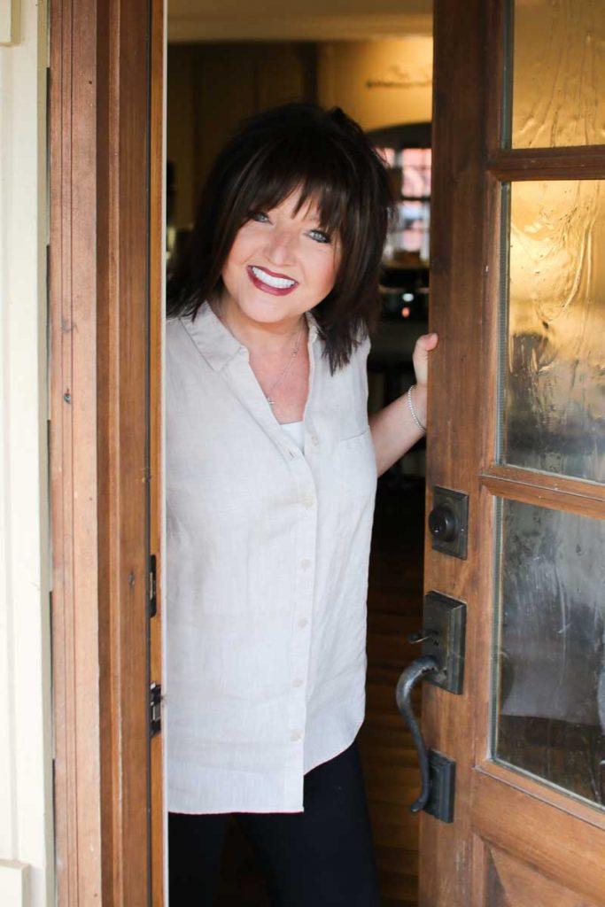 Karen Wheaton opening door to welcome