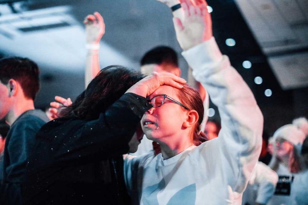 Karen Wheaton Prays over Student The Ramp